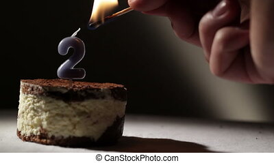 Candle two in tiramisu cake Birthday vintage background