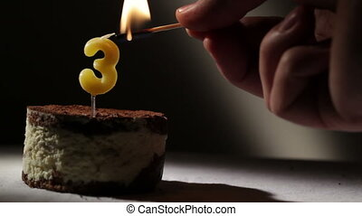 Candle three in tiramisu cake Birthday vintage background