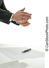 Business man clapping over a signed contract