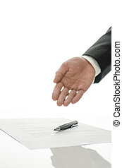 Businessman gesturing to sign a paper