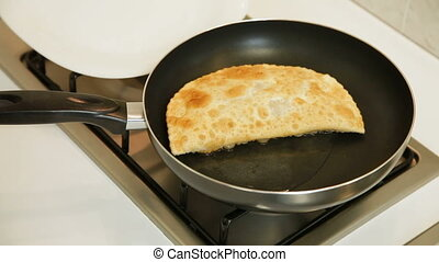 Chebureki Recipe - Woman preparing chebureki (crimean tatar...