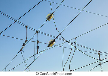 Railroad overhead lines against clear blue sky - Railroad...