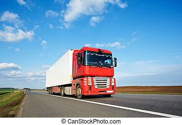 Red lorry trailer over blue sky - Moving Single red lorry...