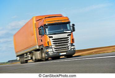 Orange lorry trailer over blue sky