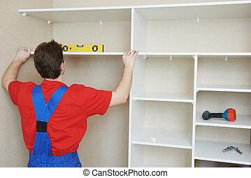Wardrobe joiner at installation work - carpenter worker...