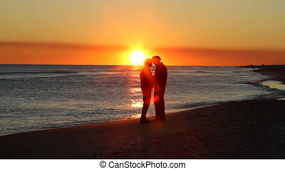 Retirees Romance Sunset - Romantic silhouette of...