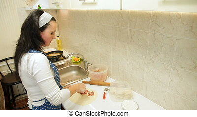 Woman Preparing Chebureki - Woman preparing chebureki...