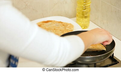 Woman Frying Chebureki - Woman preparing chebureki (popular...