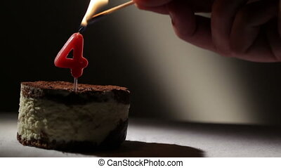 Candle four in tiramisu cake. Birthday vintage background.