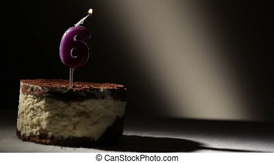 Candle six in tiramisu cake Birthday vintage background