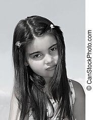 Dark Haired Young Girl - Face of a young littlegirl with...