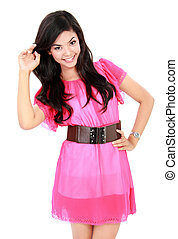 young woman in pink dress smiling at camera - Image of young...
