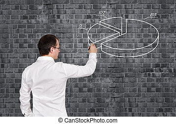 man drawing pie chart - businessman drawing pie chart on...