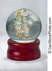 Snowglobe containing a Santa figure and Christmas Tree