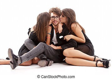 Two young attractive women kissing man - Two young...
