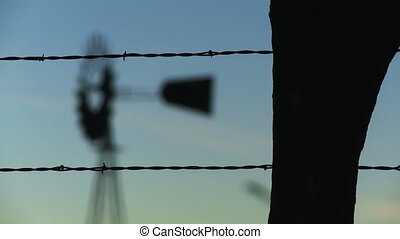 Farm Land 03 - Rack focus from a barbed wire fence in the...
