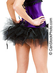 sexy young girl in a skirt and corset. View from the back