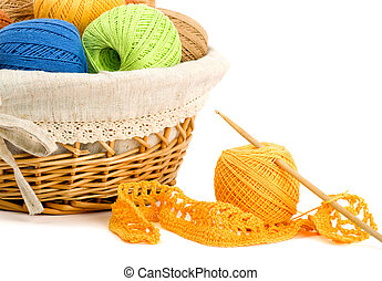 Needlework, yellow threads on white background
