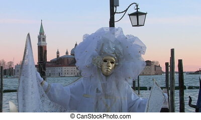 venetian mask 12 - Person in Venetian costume attends the...