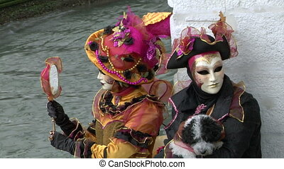 venetian mask 21 - Person in Venetian costume attends the...