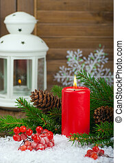 Christmas red candle and spruce branches