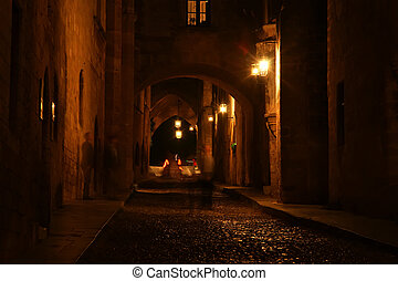 Medieval Avenue of the Knights at night, a cobblestone...