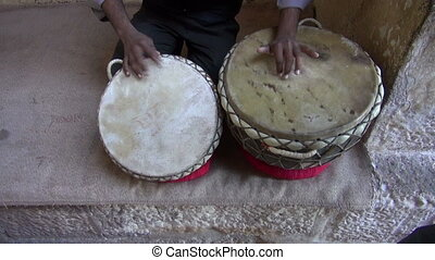 playing on indian tabla drums