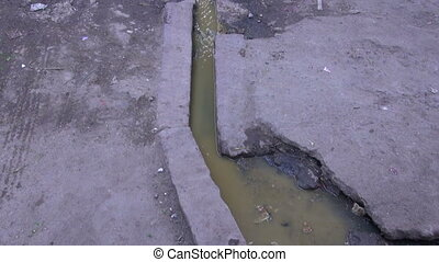 open sewerage pollution channel in Rajasthan city street,...