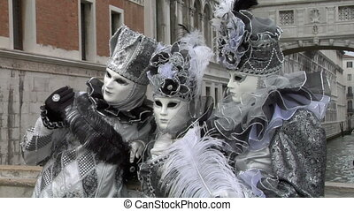 venetian mask 41 - Person in Venetian costume attends the...