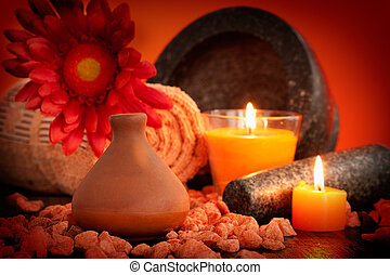 Natural spa - Spa setting in orange tones with candles....