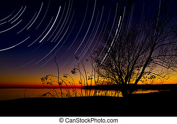 Benbrook Lake Nightfall - Star trails over Benbrook Lake in...