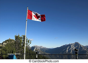 Canadian flag flutters in the wind on top of Sulpher...
