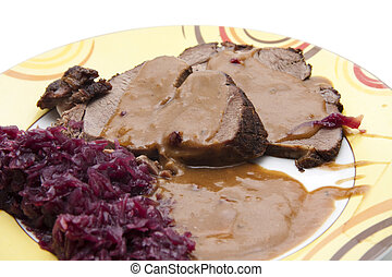 Pigs roast with red cabbage and sauce