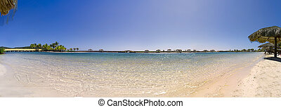 Roatan Beach Panorama - Small inlet and secluded beach in...