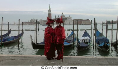 venetian mask 61 - Person in Venetian costume attends the...