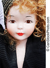 Porcelain doll - portrait of an antique porcelain doll
