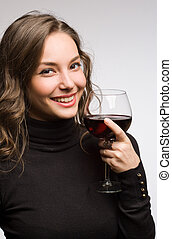 Enjoying premium wine. - Portrait of a gorgeous young...