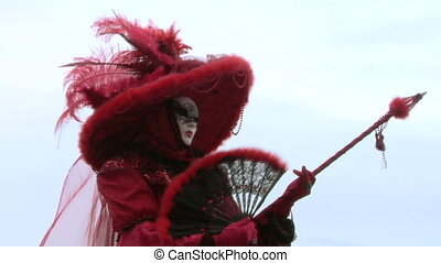 venetian mask 72 - Person in Venetian costume attends the...