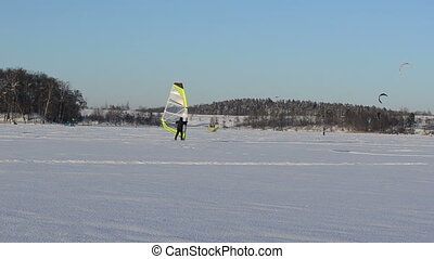ice surfer winter kiting - ice surfer man sailing surfing on...