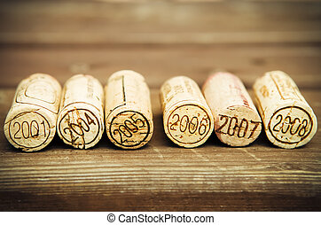 Dated wine bottle corks on the wooden background Close up