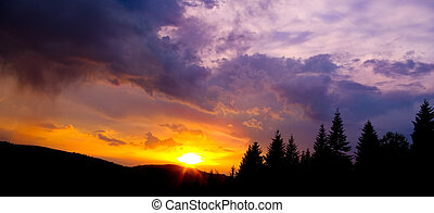 Colorful sky and silhouette of the mountains at sunset