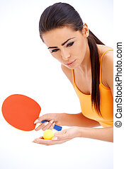Female table tennis player ready to serve