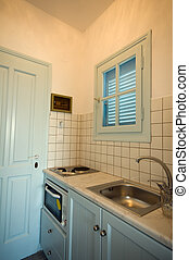 kitchen in apartment greek islands - typical small compact...