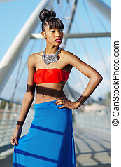 Fashion model posing in color blocking blue red clothing...