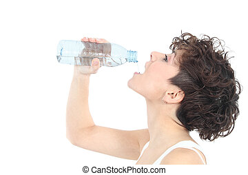 Woman drinking water from a plastic bottle
