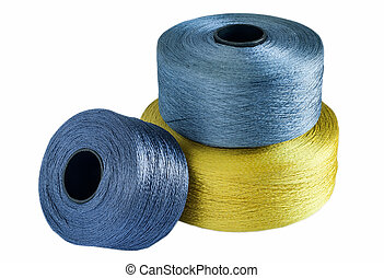 Colored silk yarn rolled on coils isolated on white...