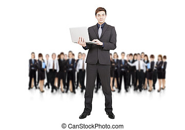 smart businessman holding laptop and successful business team