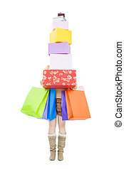 young woman holding gift box and shopping bag