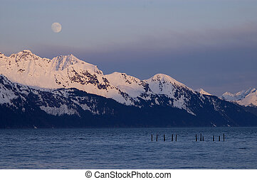 Moonrise over Alaskan Mountains - A moonrise over the...