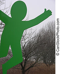 Hitching a Ride - Green cut out figure sticking out his...